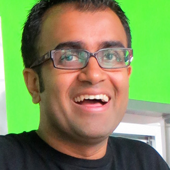 A photo of Ritesh Doshi against a green background.